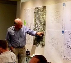 Bill Tunnell talks through how City Hall Plan might best be used at Charrette